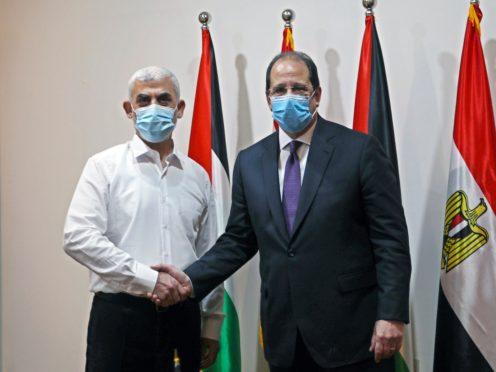 Yehiyeh Sinwar, left, the top Hamas leader in Gaza, and the head of the Egyptian General Intelligence Abbas Kamel (Ashraf Amra/Pool via AP)