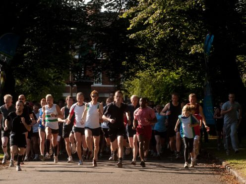 Participants in the 5km parkrun around Hyde Park in Leeds (PA)