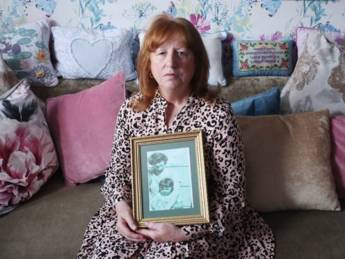 Briege Voyle holds the last picture taken of her mother Joan Connolly (Niall Carson/PA)