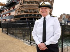 Commodore Jude Terry in front of HMS Victory (Ministry of Defence/PA)