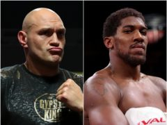 Tyson Fury (left) and Anthony Joshua will go toe-to-toe in August (PA).