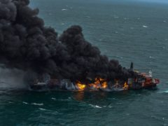 In this photo provided by Sri Lanka Air Force, smoke rises from the container vessel MV X-Press Pearl engulfed in flames off Colombo port, Sri Lanka, Tuesday, May 25, 2021. An explosion occurred Tuesday on a ship anchored off Sri Lanka's capital on which a fire had been burning for several days, prompting the evacuation of all crew members, officials said. (Sri Lanka Air Force via AP)