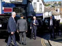 US President Joe Biden, centre, arrives for Mass at Sacred Heart and St Ia Catholic Church in St Ives, Cornwall (Patrick Semansky/AP)