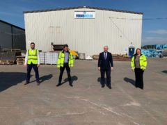 Export minister Graham Stuart celebrates with FoundOcean staff at the firm's base in Livingston (UKEF/PA)