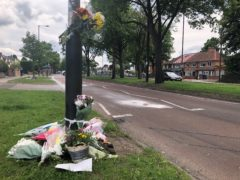 Floral tributes were left at the scene in Acocks Green, Birmingham (Matthew Cooper/PA)