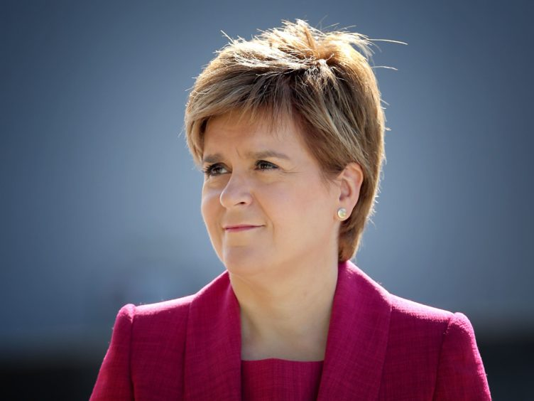 Nicola Sturgeon is being urged to press the Prime Minister on the issue of 'vaccine apartheid' (Jane Barlow/PA)