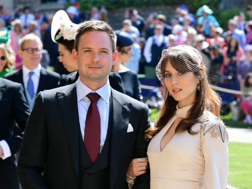 Patrick J Adams and wife Troian Bellisario at the wedding of Meghan and Harry (Ian West/PA)