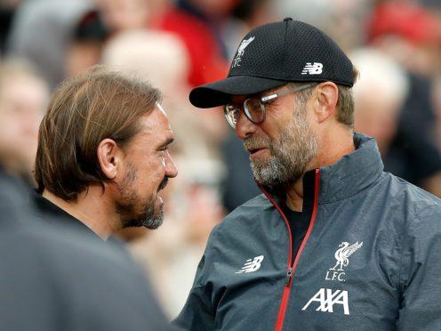 Norwich manager Daniel Farke (left) and Liverpool boss Jurgen Klopp will meet once again on the opening day (Martin Rickett/PA)