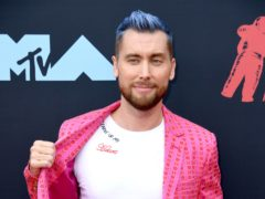 Former NSYNC singer Lance Bass revealed he and husband Michael Turchin are expecting twins (PA)