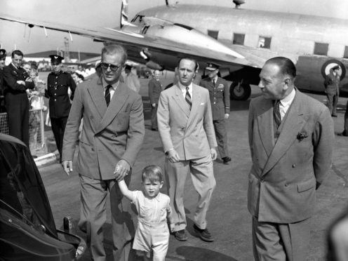 Prince Charles leading his father by the hand in 1951 (PA)