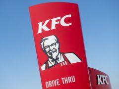 A KFC sign (PA)