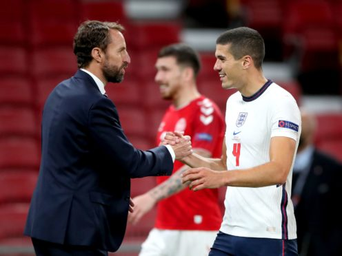 Gareth Southgate shakes hands with Conor Coady (Nick Potts/PA)