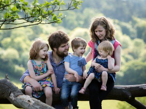 Zoe Powell and husband Josh with children Phoebe, Simeon and Amelia (Sarah Mak Photography/PA)