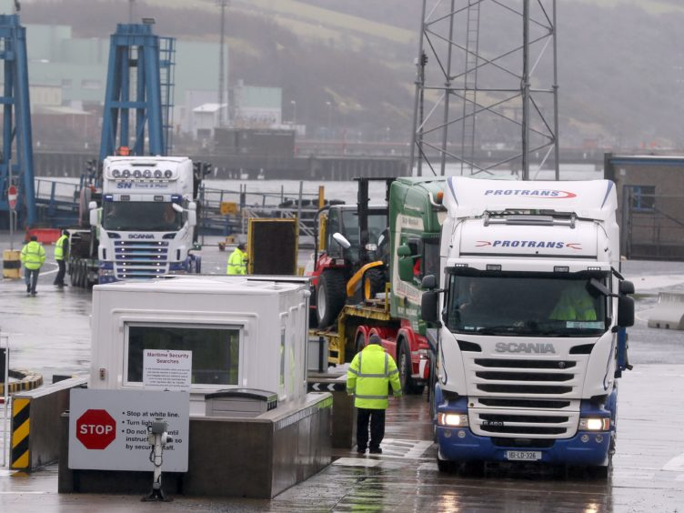 Trucks leaving Larne Port, where they have to undergo new checks as part of the NI Protocol (Brian Lawless/PA)