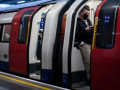 Commuters on a tube train (Aaron Chown/PA)