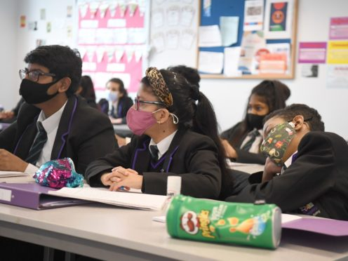Children wearing face masks during a lesson at Hounslow Kingsley Academy in West London (Kirsty O'Connor/PA)