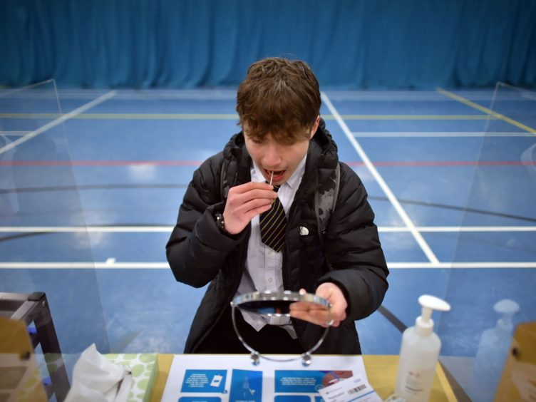 Pupils have been urged to get tested upon their return from the half-term break (Ben Birchall/PA)