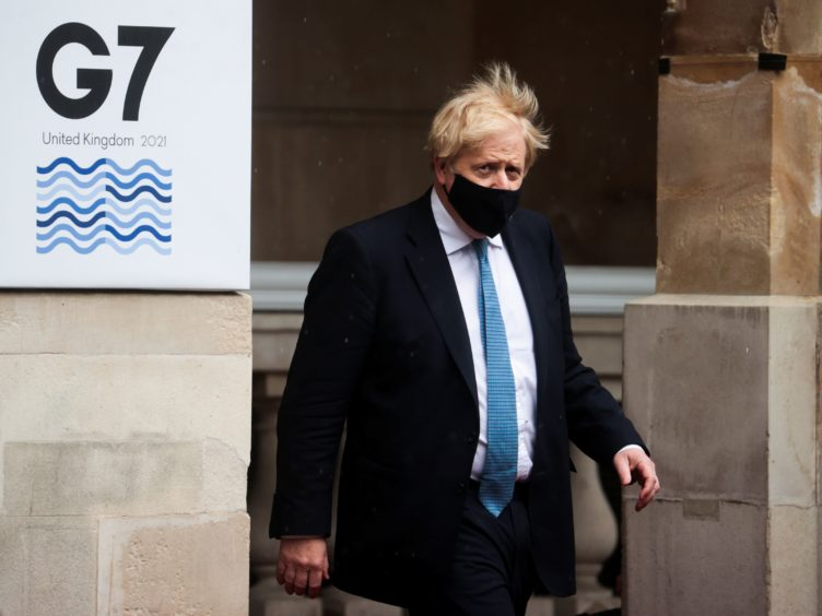 Prime Minister Boris Johnson leaves Lancaster House, London, after visiting the G7 foreign and development ministers meeting (Hannah McKay/PA)