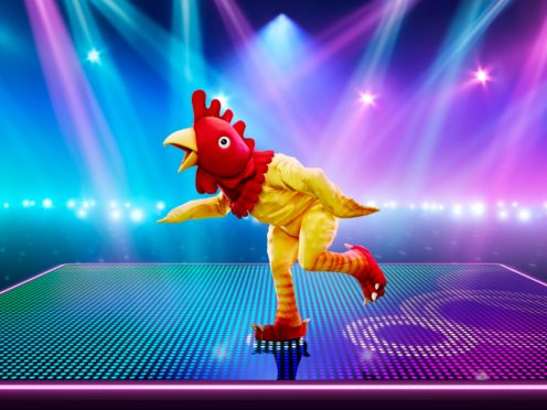 Ski jumper Eddie the Eagle has been identified as Rubber Chicken on The Masked Dancer (ITV/PA)
