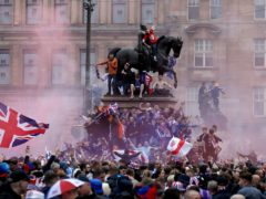 Rangers fans celebrating the club's title win in George Square, Glasgow (Andrew Milligan/PA)