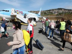 Passengers disembarking from an early morning flight to Madeira (Joe Pepler/PinPep)