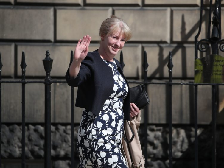 Shona Robison argues that Scotland needs more devolved powers to increase wages, reduce insecure work and create fairer workplaces (Andrew Milligan/PA)