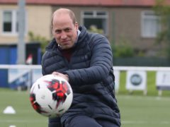 The Duke of Cambridge on the pitch during a visit to Spartans FC's Ainslie Park Stadium in Edinburgh to hear about initiatives in Scottish football that champion mental health ahead of the Scottish Cup Final on Saturday. Picture date: Friday May 21, 2021.