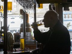 A man drinking in a public house (Jane Barlow/PA)