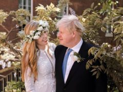 Handout photo of Prime Minister Boris Johnson and Carrie Johnson in the garden of 10 Downing Street after their wedding (Rebecca Fulton/PA)