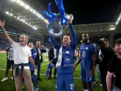 Ben Chilwell celebrates with the trophy after the UEFA Champions League final match held at Estadio do Dragao in Porto, Portugal. Picture date: Saturday May 29, 2021.