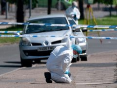 A forensics officer at the scene on College Road, Kingstanding, Birmingham (Jacob King/PA)