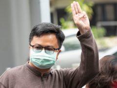 Pro-democracy activist Arnon Nampha raises a three-fingered symbol of resistance at the criminal court in Bangkok, Thailand (Sakchai Lalit/AP)