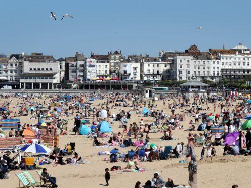 People enjoy the beach in Margate, Kent (Gareth Fuller/PA)