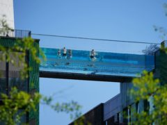 People made the most of the balmy conditions by swimming in London's Sky Pool (Aaron Chown/PA)