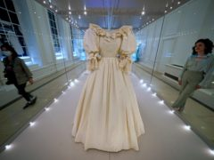The Princess of Wales' wedding dress is prepared for display at Royal Style in the Making, a new exhibition at Kensington Palace in London, which opens to the public on June 3. Picture date: Wednesday June 2, 2021.