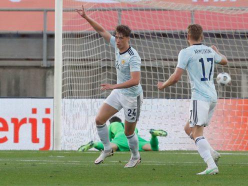 Scotland's Jack Hendry, left, scored the opening goal (Miguel Morenatti/AP)
