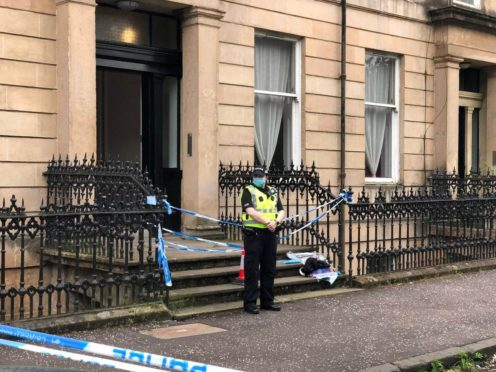 Police outside Esther Brown's home at West Princes Street in Woodlands, Glasgow (Douglas Barrie/PA)