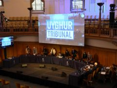 Members of the independent tribunal take their seats for the first session of the hearings at Church House, in London (AP/Alberto Pezzali)