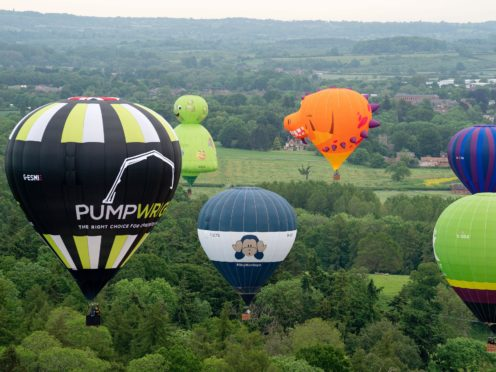 Balloonists take flight during the opening of the Midlands Air Festival in Alcester, Warwickshire (Jacob King/PA)