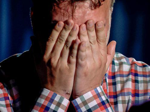 Raman Pratasevich cries during his interview (ONT channel via AP)