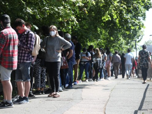 People queuing to go into Belmont Health Centre in Harrow for their Covid-19 vaccine (Jonathan Brady/PA)