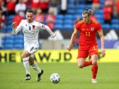Wales' Gareth Bale, right, and Albania's Sherif Kallaku battle for the ball during their goalless draw in Cardiff (Nick Potts/PA)