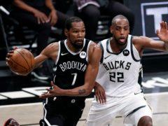 Brooklyn Nets forward Kevin Durant (left) drives to the basket past Milwaukee Bucks forward Khris Middleton (Adam Hunger/AP)