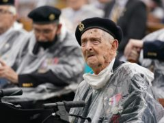 Veterans watch the official opening of the British Normandy Memorial in France via a live feed (Jacob King/PA)