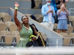 Serena Williams waves to the crowd following her loss to Elena Rybakina (Michel Euler/AP)