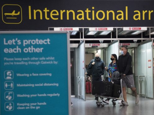 Passengers arrive at Gatwick Airport (Kirsty O'Connor/PA)