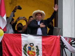Presidential candidate Pedro Castillo waves to supporters (Martin Mejia/AP)