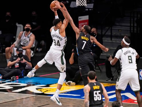 Brooklyn Nets forward Kevin Durant (7) tries to block a shot by Milwaukee Bucks forward Giannis Antetokounmpo during the Bucks' narrow win on Thursday night (Kathy Willens/AP)