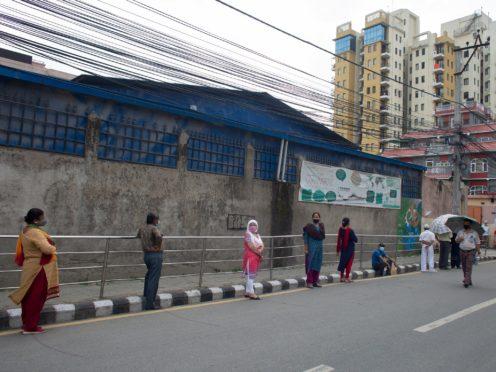 Nepalese people line up to get inoculated against coronavirus (Bikram Rai/AP)