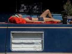 Time to top up the tan as UK heads for a heatwave (Kirsty O'Connor/PA)